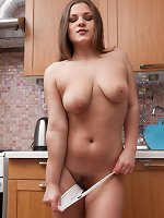 Bella Moore masturbates in her kitchen to orgasm